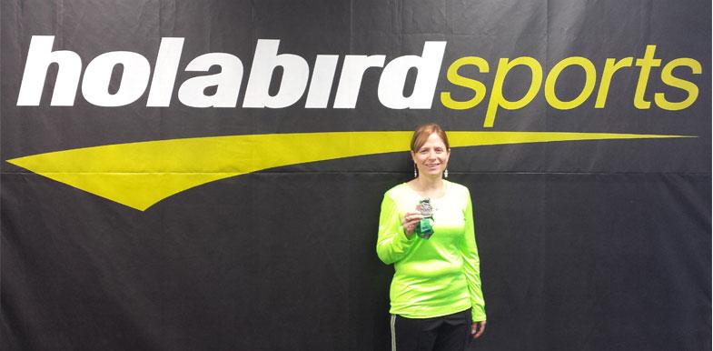 Noelle holding her well-deserved Baltimore Marathon medal.
