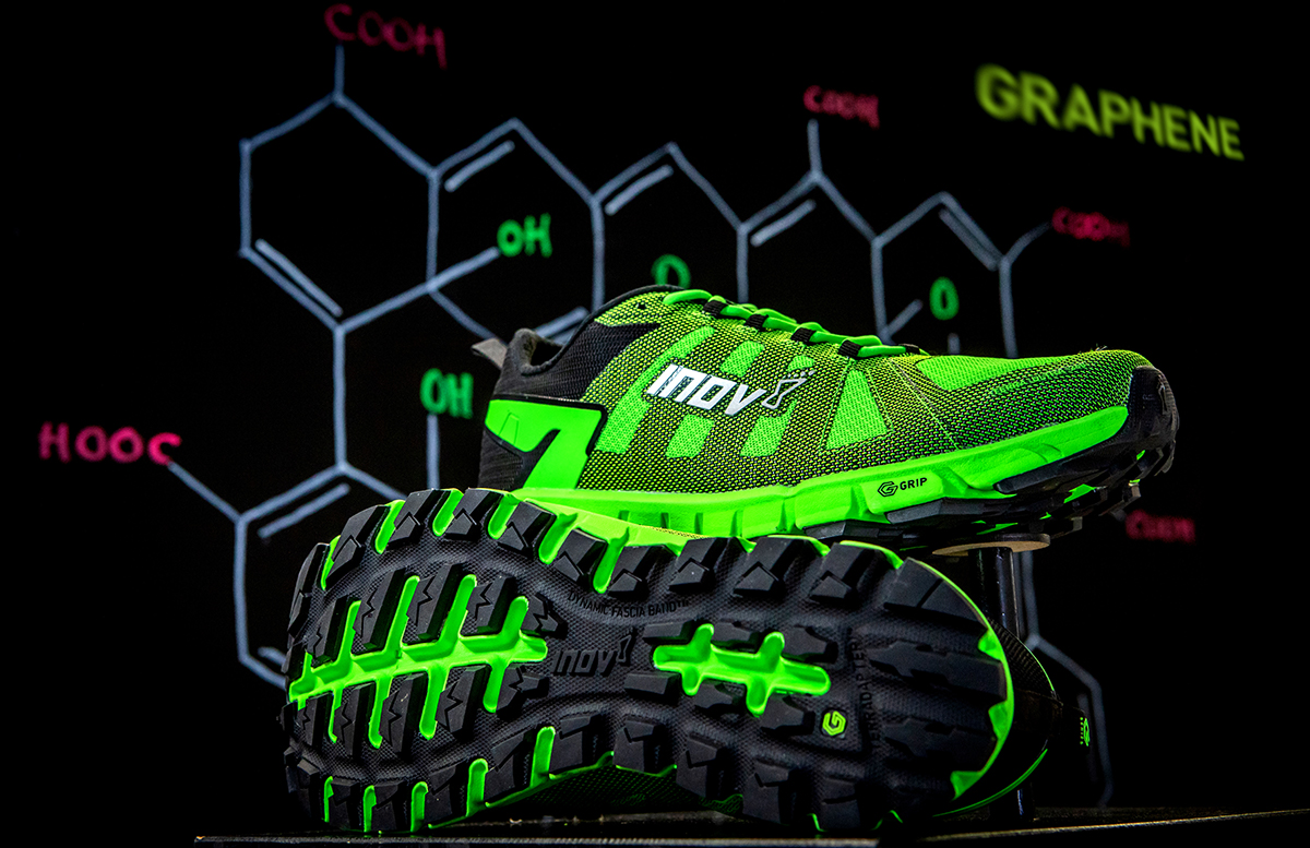 inov-8 G-Series TerraUltra shoe against a chemistry backdrop